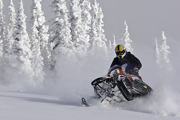 Snowmobiler riding in the backcountry of Jackson Hole