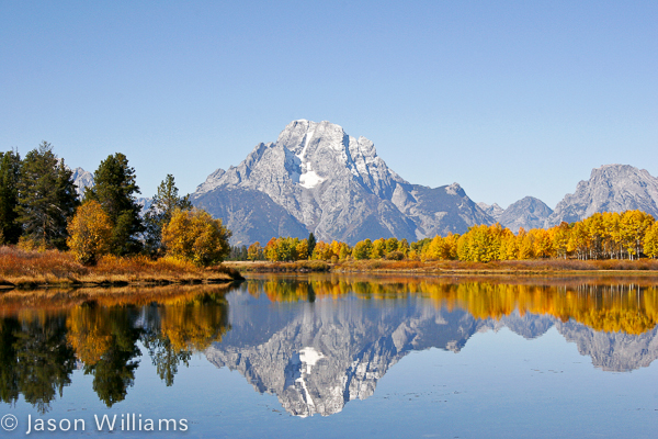 Mount Moran With Fall Foliage Reflects Off The Owbow Bend Of The Snake River In Grand Teton National Park