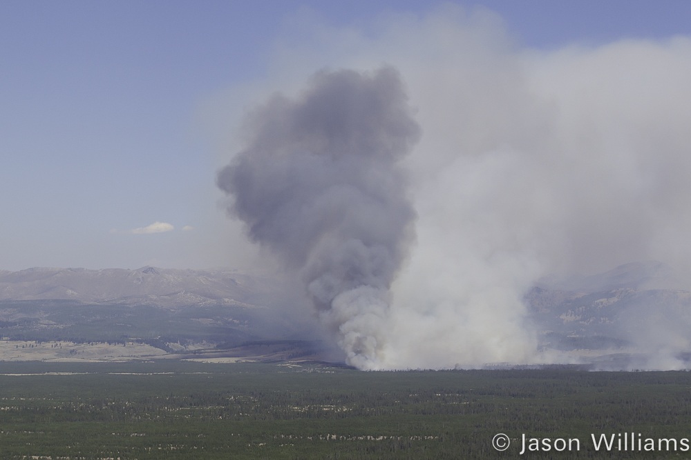A Giant Plume Of Smoke Is Seen On The Yellowstone National Park Landscape As The Maple Fire Burns