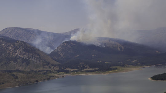 A Plume Of Smoke From The Berry Forest Fire In Grand Teton National Park Can Be Seen Rising Above The Lake