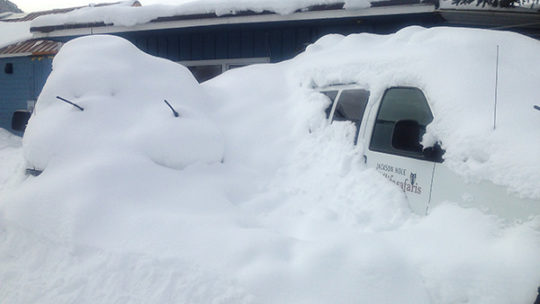 A Winter Snow Storm Buries A Jackson Hole Wildlife Safaris Van In The Parking Lot