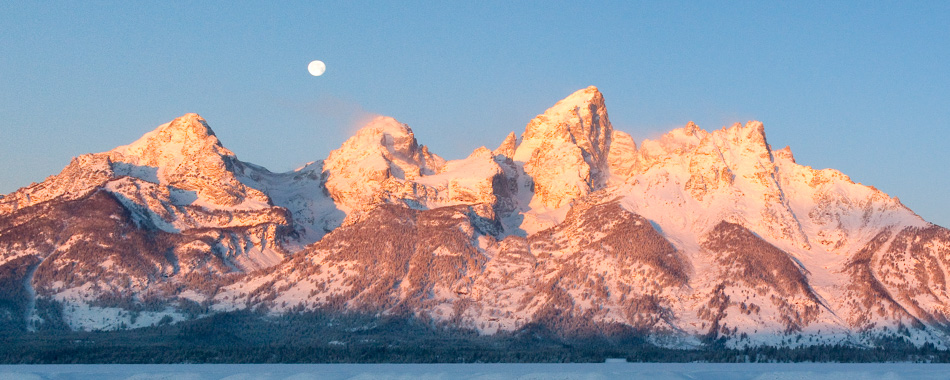 Grand Tetons at sunrise with moon rising above