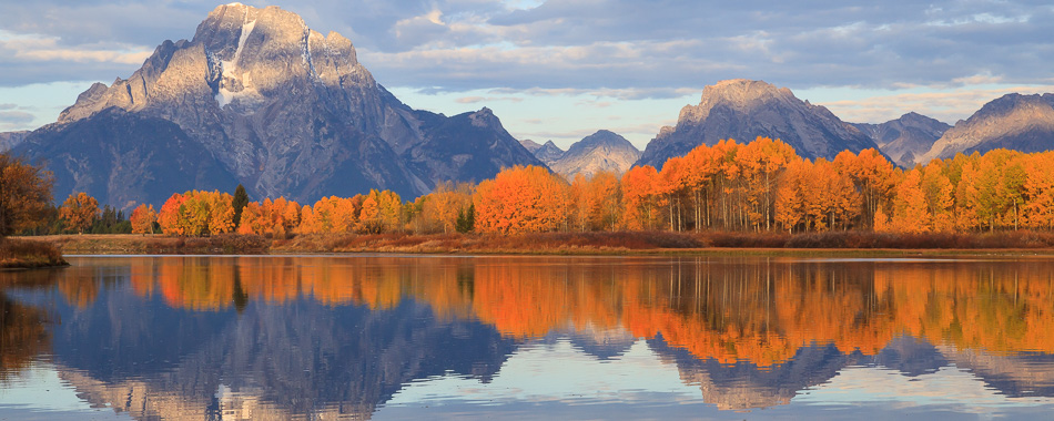 Mount Moran reflecting in the Oxbow Bend of the Snake River with fall colors in Jackson Hole.