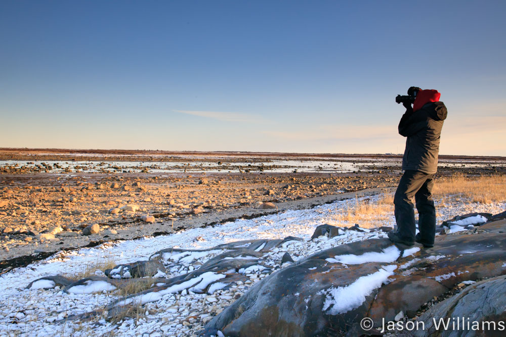 Photographer shooting the scenery of the coastline of Hudson Bay at low tide.