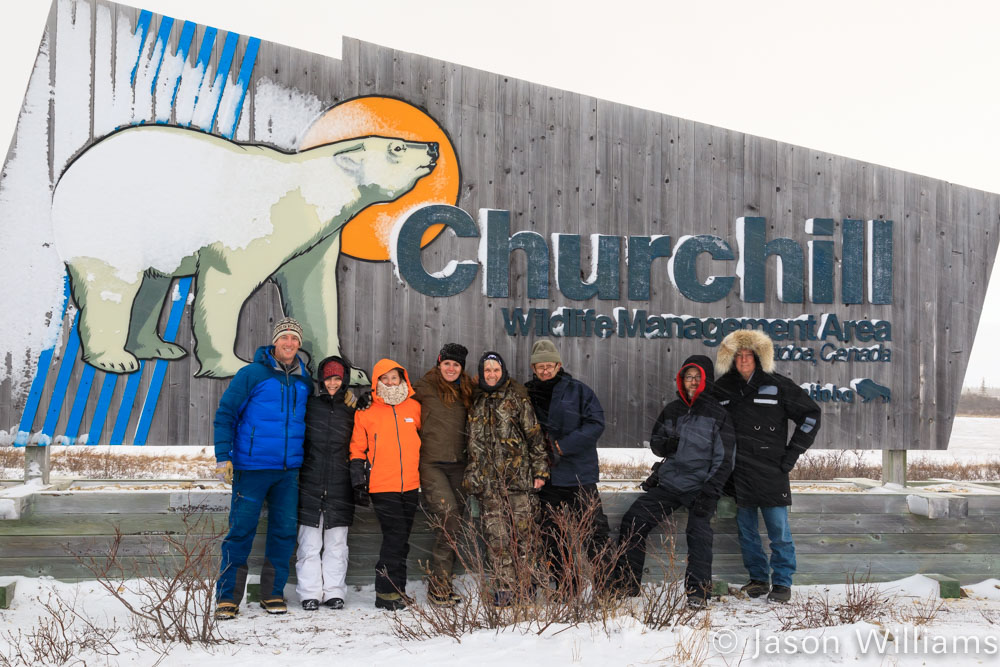 Group of polar bear photographers with the Churchill Northern Studies Center sign. Image by Jason Williams