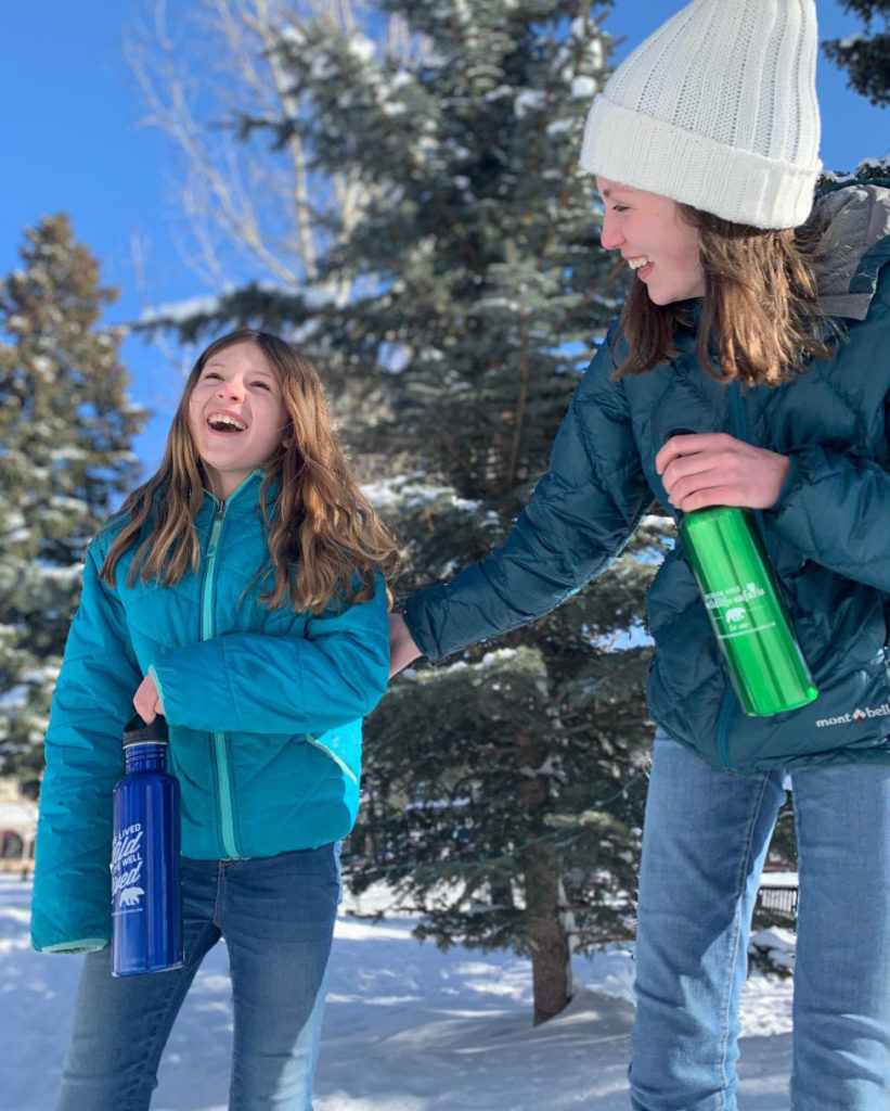 Sisters take their reusable water bottles on safari in Jackson Hole, Wyoming.