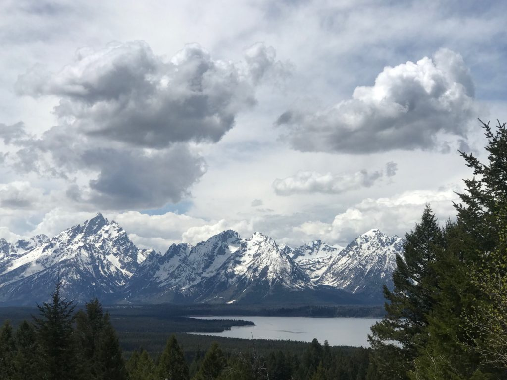 Jackson Hole lake with mountains surrounding it