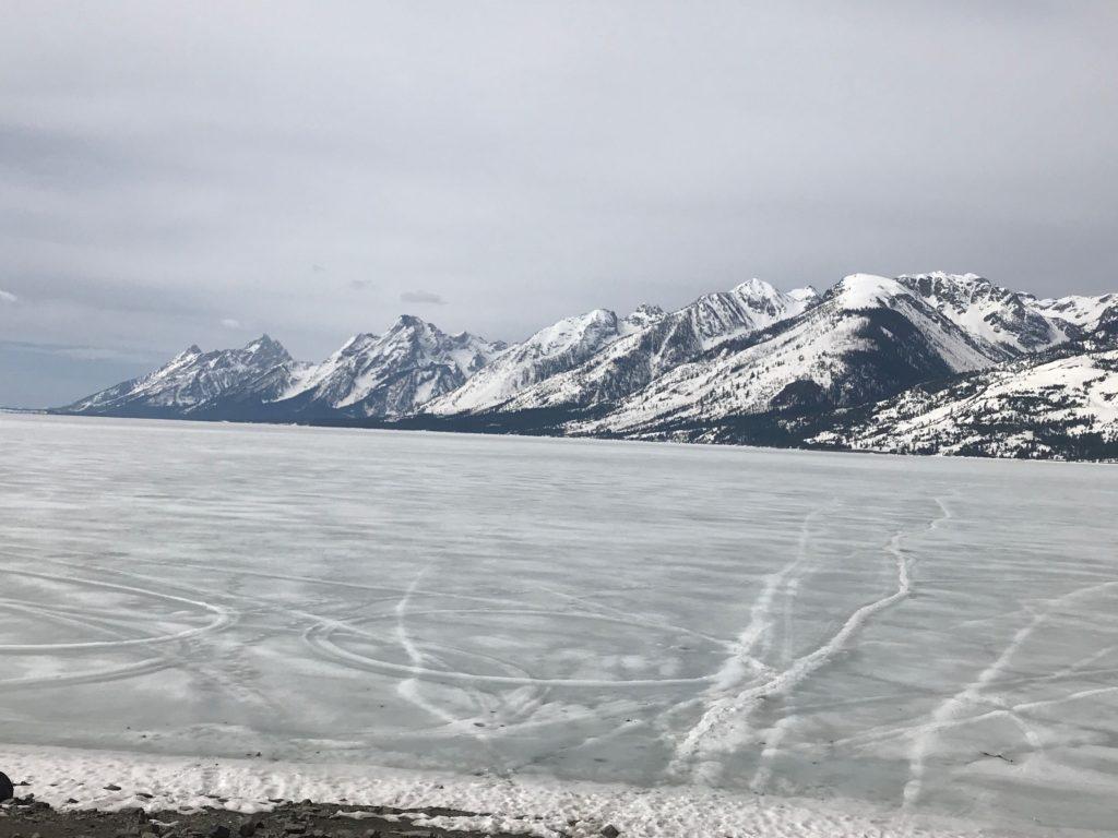 Beautiful mountains surrounding icy lake