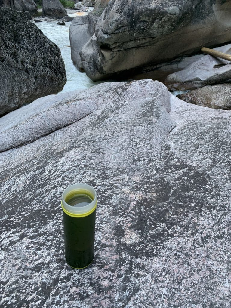 water bottle on rock