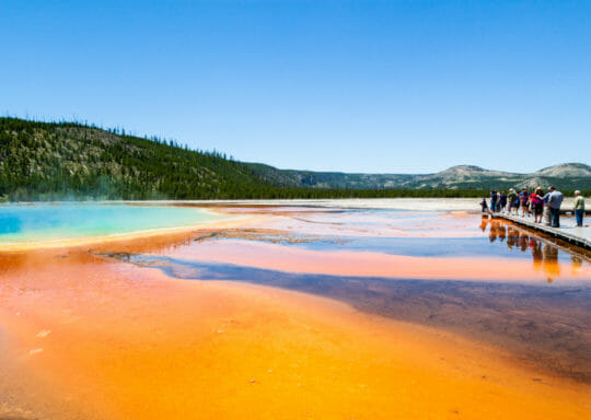 tourists visiting the Grand Prismatic Spring in Yellowstone National Park