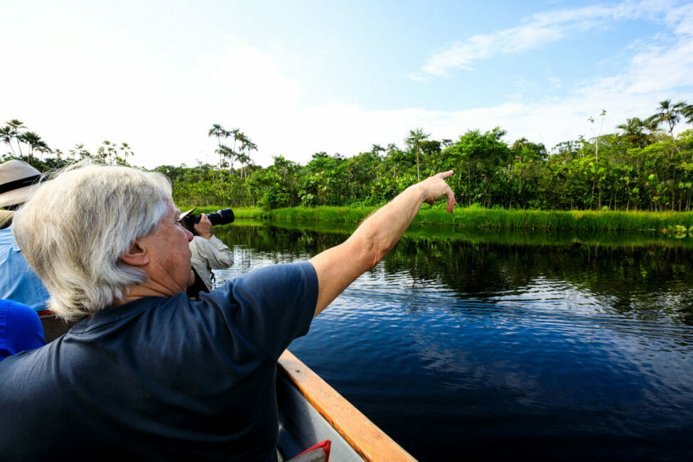 tourists on canoe exploring the amazon
