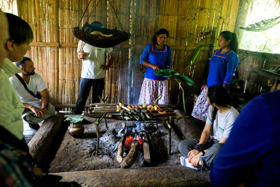 family in ecuador cooking over fire