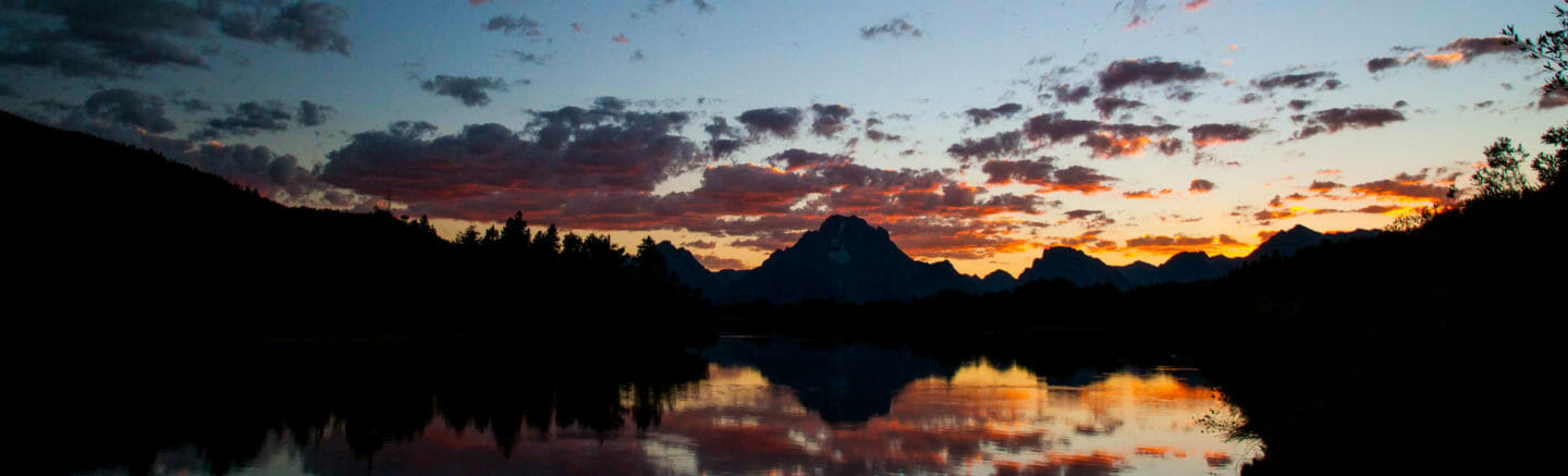 Sunset the Tetons reflected in the Oxbow Bend of the Snake River.