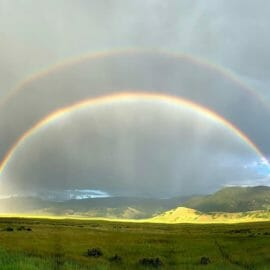 A Rare Full Double Rainbow Appears In The Sky Over The National Elk Refuge In Jackson Hole Wyoming