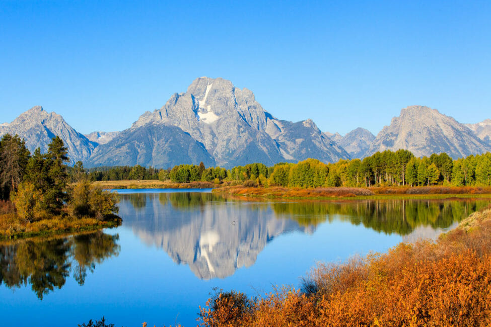 Reflection of Mount Moran in the Oxbow Bend of the Snake River in Grand Teton National Park.