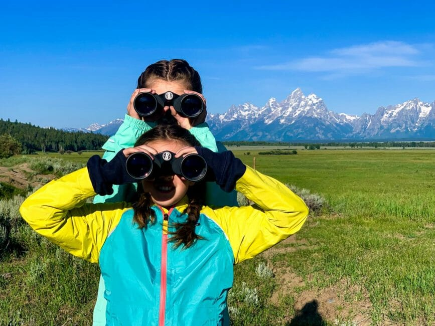 Kids watching wildlife on safari in Grand Teton National Park