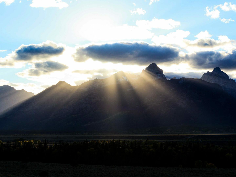 Sun Rays Break Over The Peaks Of The Teton Mountain Range In Grand Teton National Park