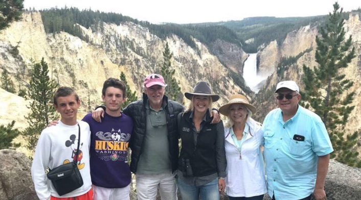 Professional Guide Ash Tallmadge Stands With Wildlife Safari Guests At The Overlook To The Lower Falls In Yellowstone National Park