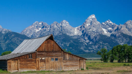 The Moulton Barn With The Grand Tetons In The Background Is A Historic Jackson Hole Site