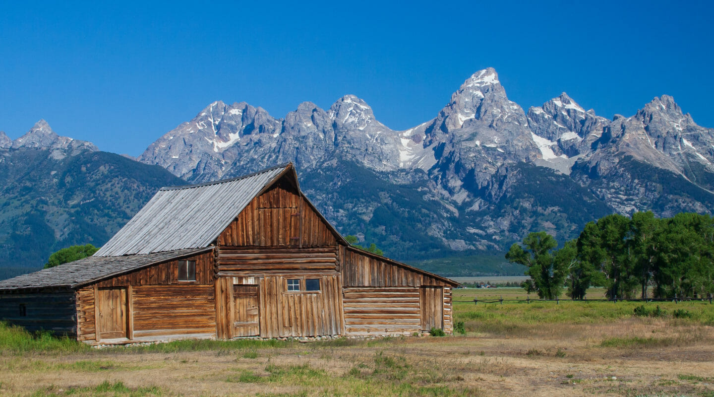 The Historic Moulton Barn Is Seen Against The Backdrop Of The Grand Teton Range in Jackson Hole Wyoming