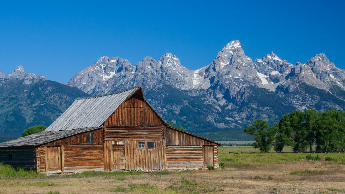 The Moulton Barn With The Grand Teton Range In The Background Is An Iconic Photograph Of A Jackson Hole Homestead